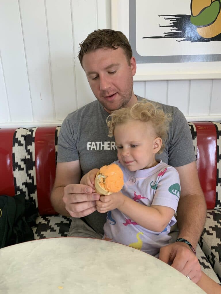 dad with little boy and ice cream